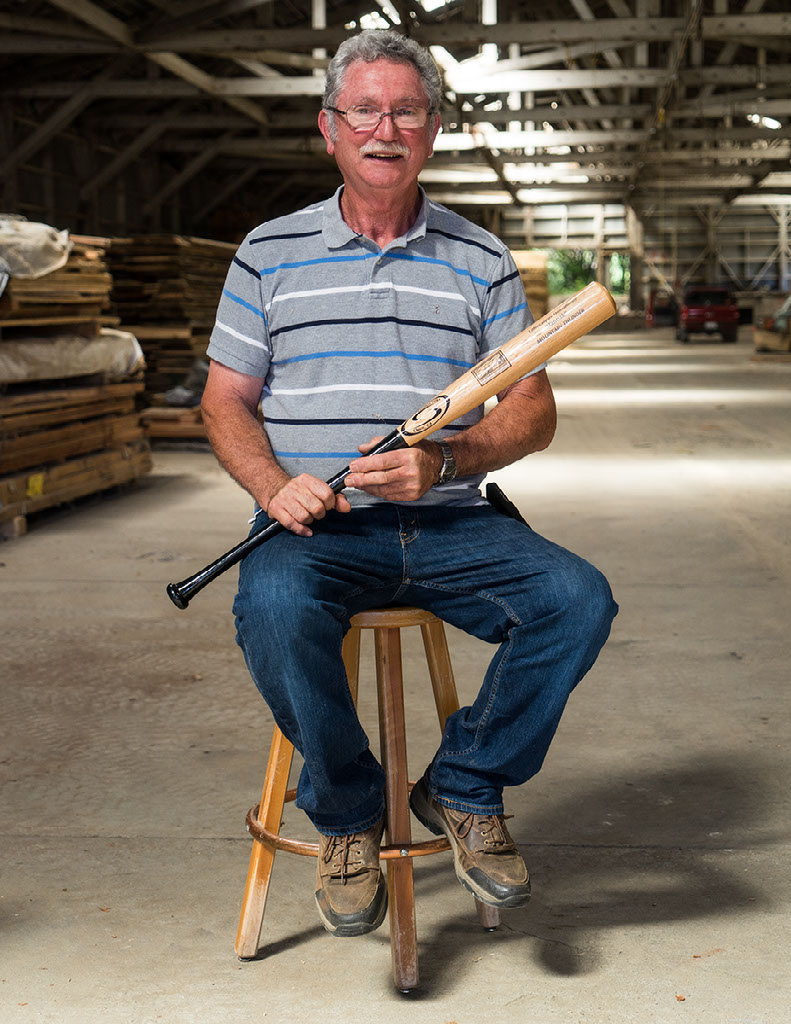 Jim Jungwirth sports a prototype of Mountain Thunder; a tanoak baseball bat which he hopes will be manufactured in Hayfork, CA.