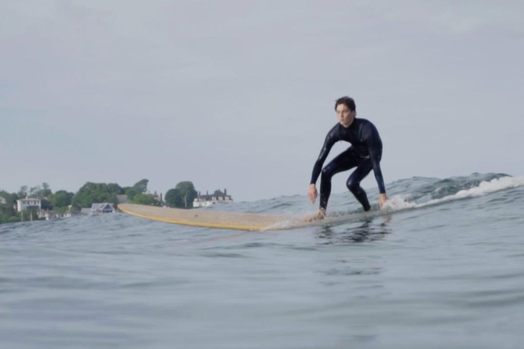 Surfer on Grain Surfboards board.
