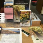 stickers on a table with informational pamphlets